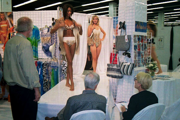 Models working at a swimwear trade show in Miami