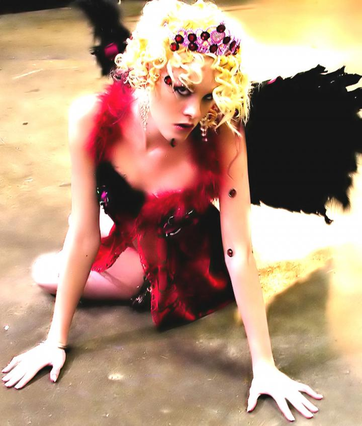 Female model photo shoot of Ember Skye  in Hard rock Live, Orlando, Florida
