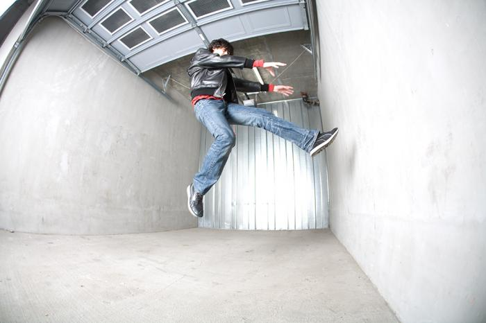 Male model photo shoot of Charles B in parking garage in downtown long beach