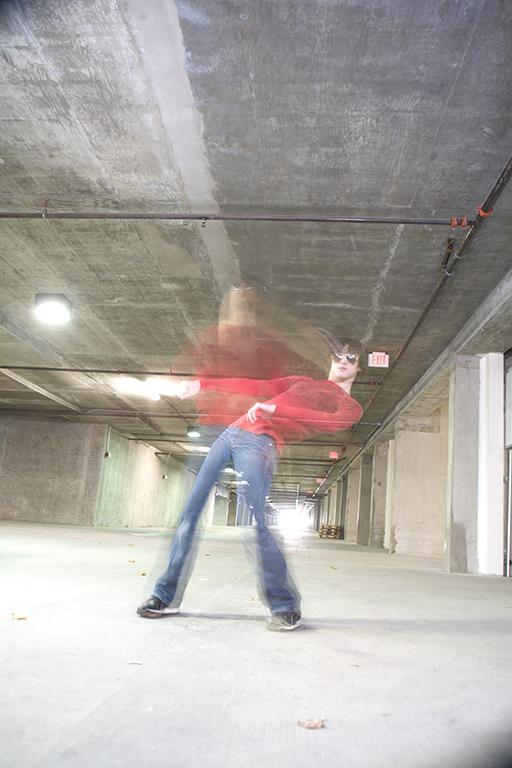 Male model photo shoot of Charles B in Parking Garage in Long Beach