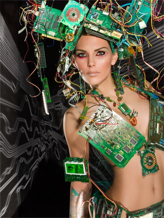 In Cyber-Space May 25, 2006 Suzzette Troche-Stapp.  This piece was used in a Dyna-Lite ad.  I worked on this piece off and on for two and 1/2 years.  This is my concept of the fusion of fashion, beauty art and technology.This is the upgraded unit with the new CPUs and processor types :-)... Model - Leah Michele.