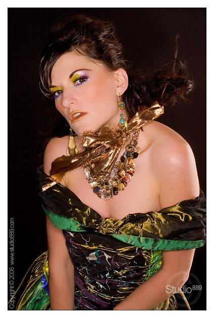 Female model photo shoot of ESMEE, makeup by TEXTURES, clothing designed by PapuszaCouture