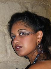 Female model photo shoot of Devika J Singh, clothing designed by Vanessa Lee Wishart