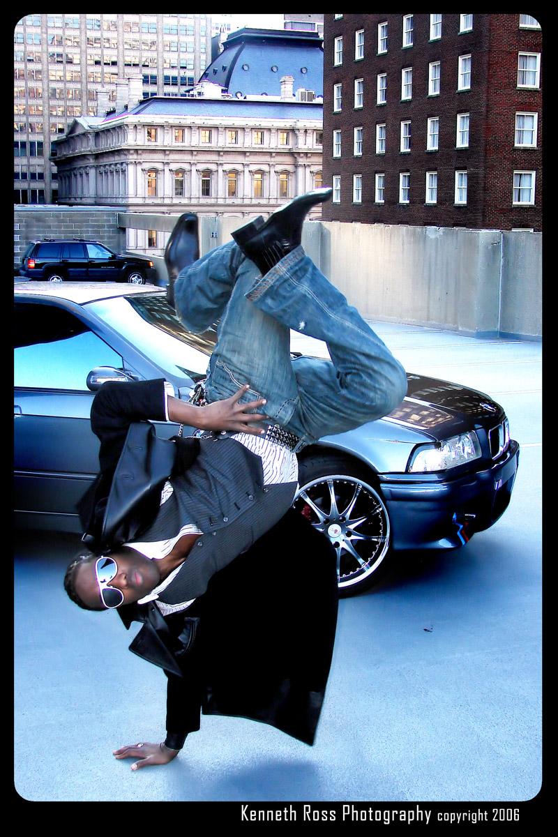 Male model photo shoot of Kross Studios in Downtown Garage roof