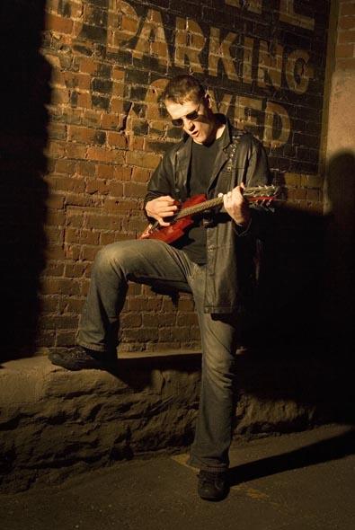 Male model photo shoot of Schwarz in Dark alley downtown