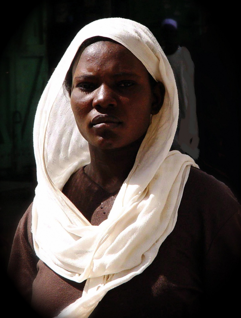 Omdurman, Sudan May 30, 2007 ©  J V O Weaver, 2005 Lady in Omdurman was walking down the street.  This was a grab shot, completely unrehersed.