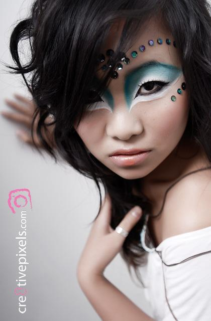 Female model photo shoot of Anqi by Danial Gowans, makeup by LePHUNK Makup Artistry