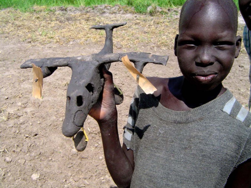 Lankien, Sudan Jul 22, 2007 2005 J V O Weaver This boy made this Mud airplane, and was proud to show it to me.  Incredible attention to detail.