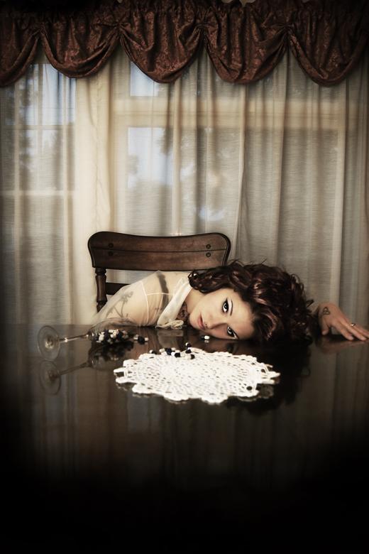 Female model photo shoot of Paperdoll Photo