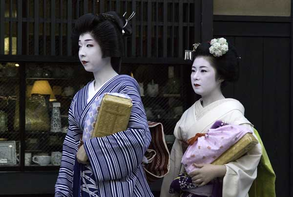 Gion district of Kyoto, Japan Oct 02, 2007 S. J. Tomioka Geisha and Maiko on their way to see a client