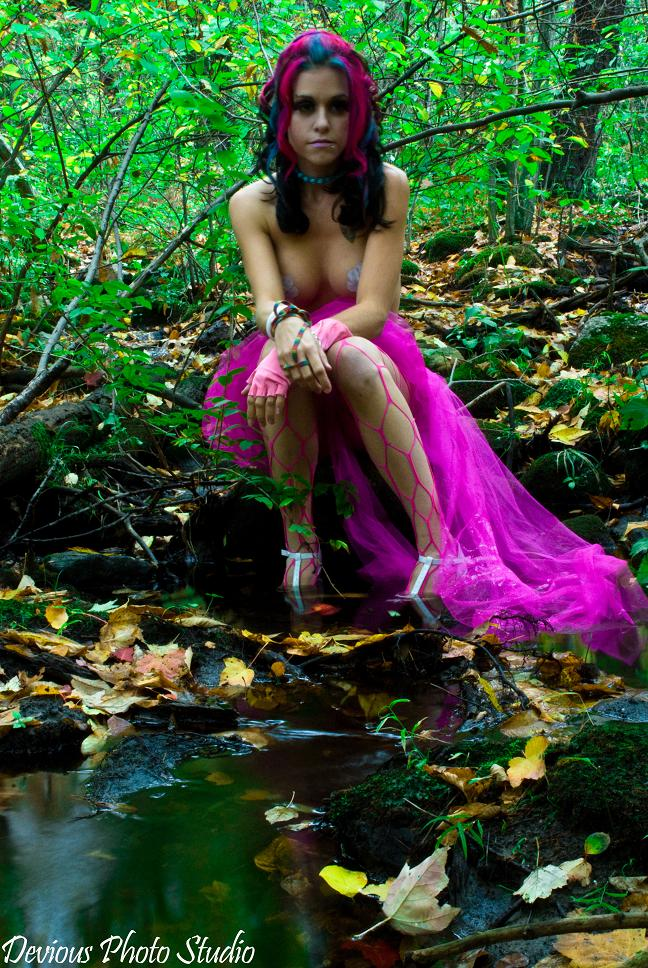 Female model photo shoot of Catherine K Foxx by devious photo studios, makeup by Lilium Makeup Artistry