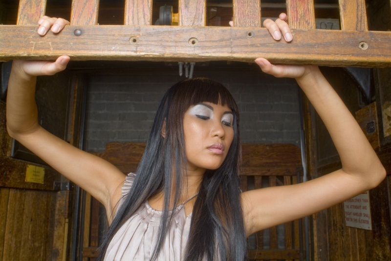 Female model photo shoot of Genre Inc and s h a i by Pete Soos, hair styled by Gen Inc