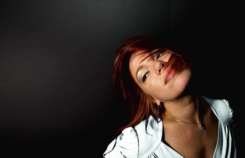 Female model photo shoot of redzy in my living room