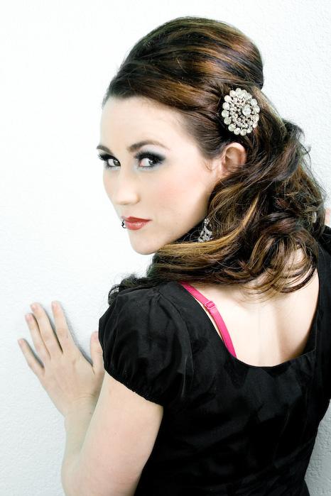 Female model photo shoot of Iris Hair and Makeup