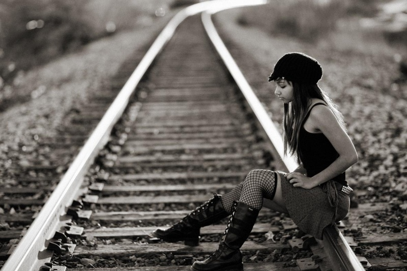 Female model photo shoot of Kiara Jade in Railroad tracks