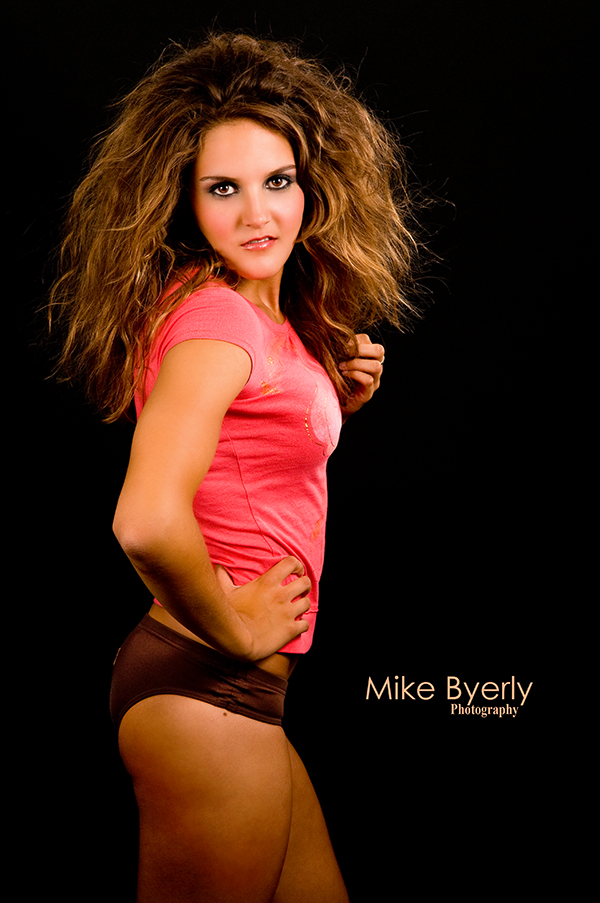 Female model photo shoot of Iris Hair and Makeup by Mike Byerly Photography in Mike Byerlys Studio