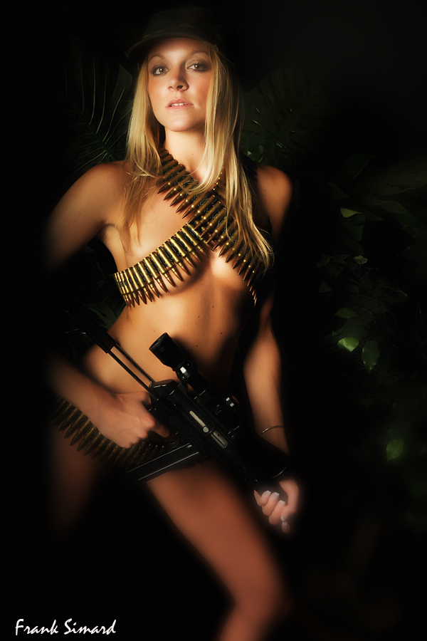 Covershot Studios Jun 25, 2008 Frank Simard Katelyn wields the weapon in the jungle