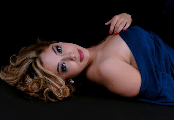 Female model photo shoot of Dawnelle84 in Ripon, hair styled by Iris Hair and Makeup