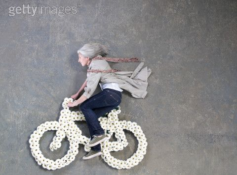 Jul 17, 2008 Getty Images - Photographer: Philip Lee Harvey Riding flower bicycle