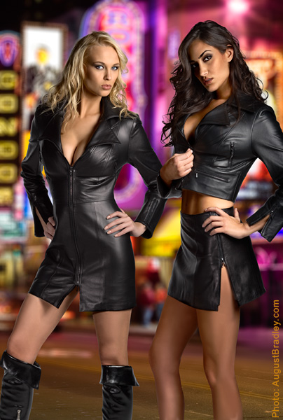 est Coast Leather on location Broadway in North Beach Aug 07, 2008 West Coast Leather International \ photographer August Bradley  Models Irina Verona and Donna Feldman in black lambskin 2 way zip coat dress and low wasit mini skirt and cropped zip motto