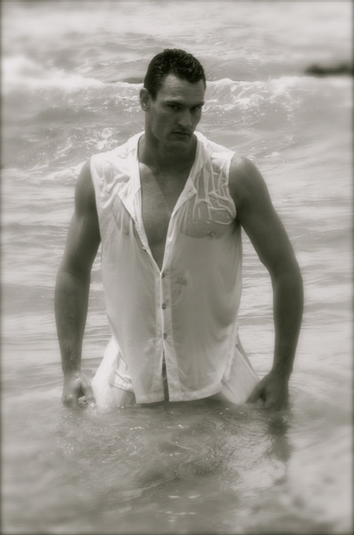 Male model photo shoot of BODYTORQUE in portugal beach