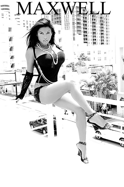 14th and collins, miami beach Oct 16, 2008 jim maxwell photography claudia verela sittin on top of the world