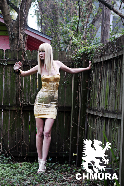 Tampa, FL Mar 16, 2009 SIDEWINDER dress. gold crepe back satin with sequenced overlay. price upon request. model: GENII