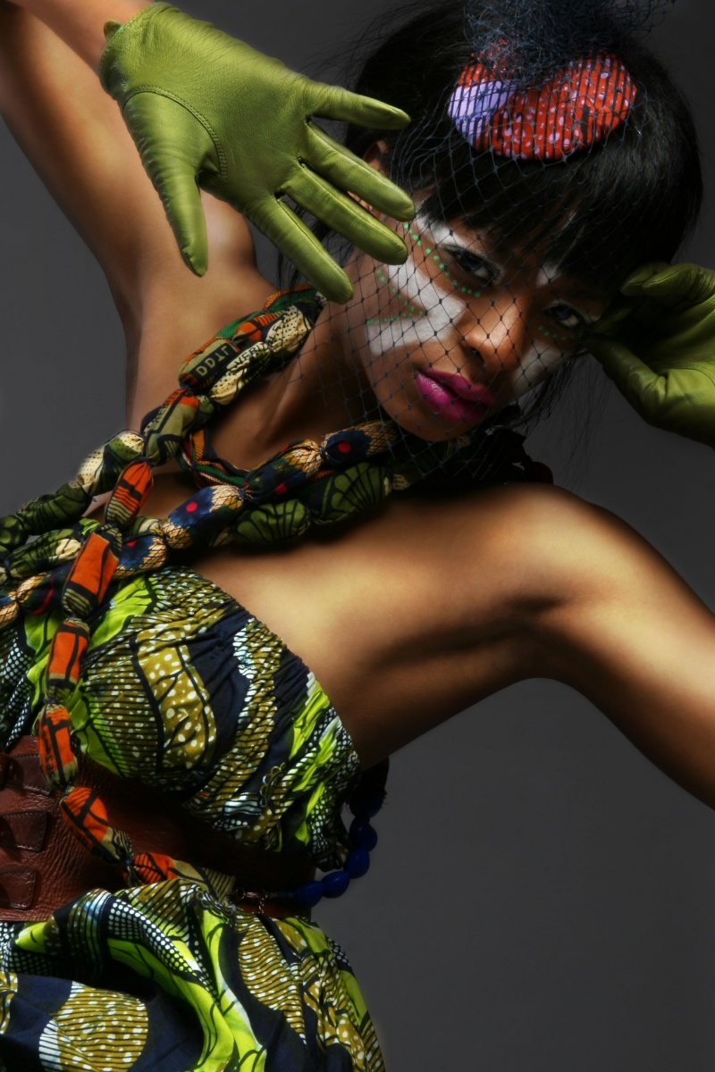 Female model photo shoot of Afro-chique and BabyTyra by AO_PHOTOGRAPHY, makeup by Sophia Danielle