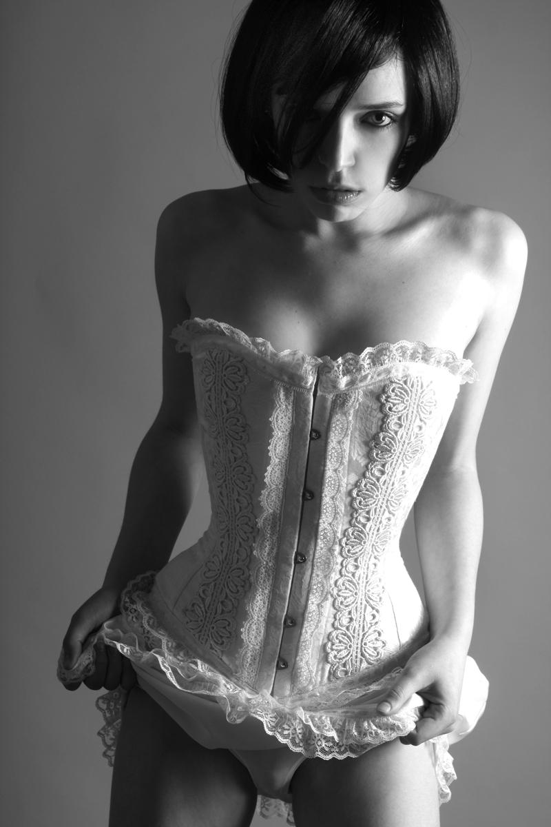 Female model photo shoot of Kess M by AZZARA , makeup by Kess MUA, clothing designed by Karen von Oppen