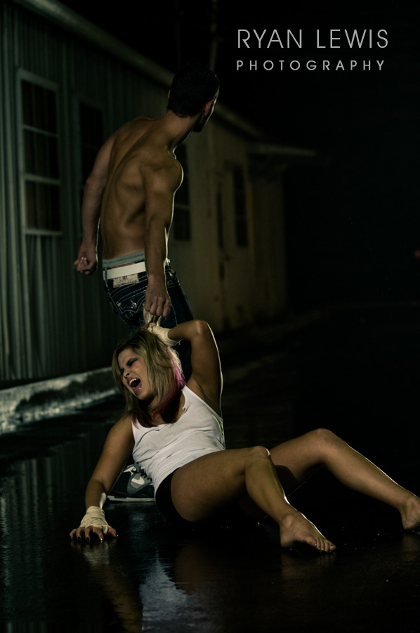 Male model photo shoot of Ryan Lewis Studio in wet dark alley