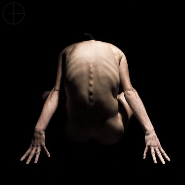 Austin, Texas Jun 03, 2009 2009 David Gilder Art nude with high angle lighting to highlight the ribs and spine