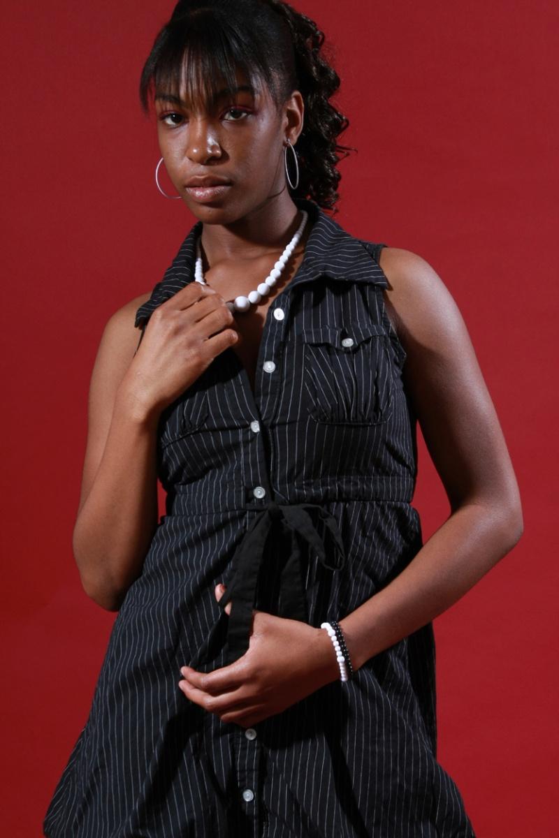 Female model photo shoot of Rainye Johnson by Rob C Photography in Studio