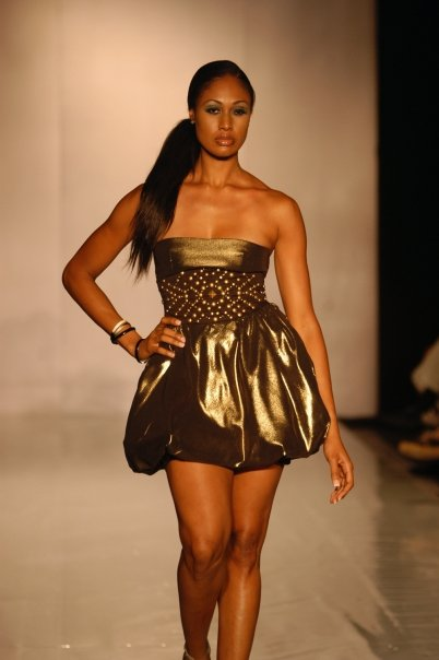 Nassau, the Bahamas Jun 12, 2009 Islands of the World Fashion Week Van der Vlugt Gold Shimmer Bubble Dress with Studded Black Waistband