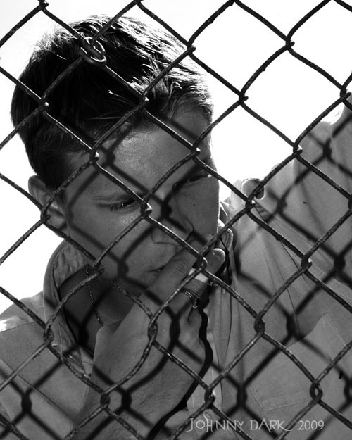 Male model photo shoot of Johnny Dark in Columbia SC, (some old fence)