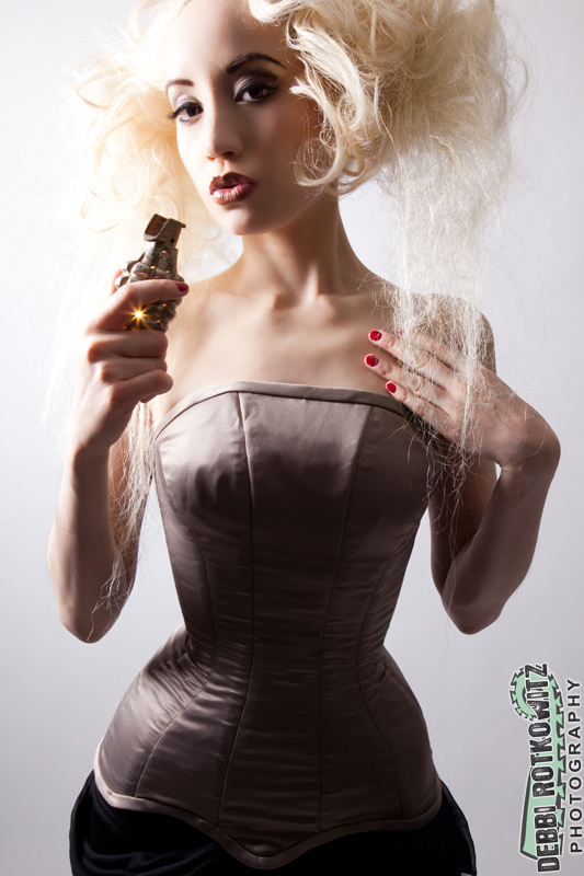 LA Aug 10, 2009 Debbi Rotkowitz Grenade. hair/mua: Angel Jagger, corset & metal grenade by Jessica Darwin