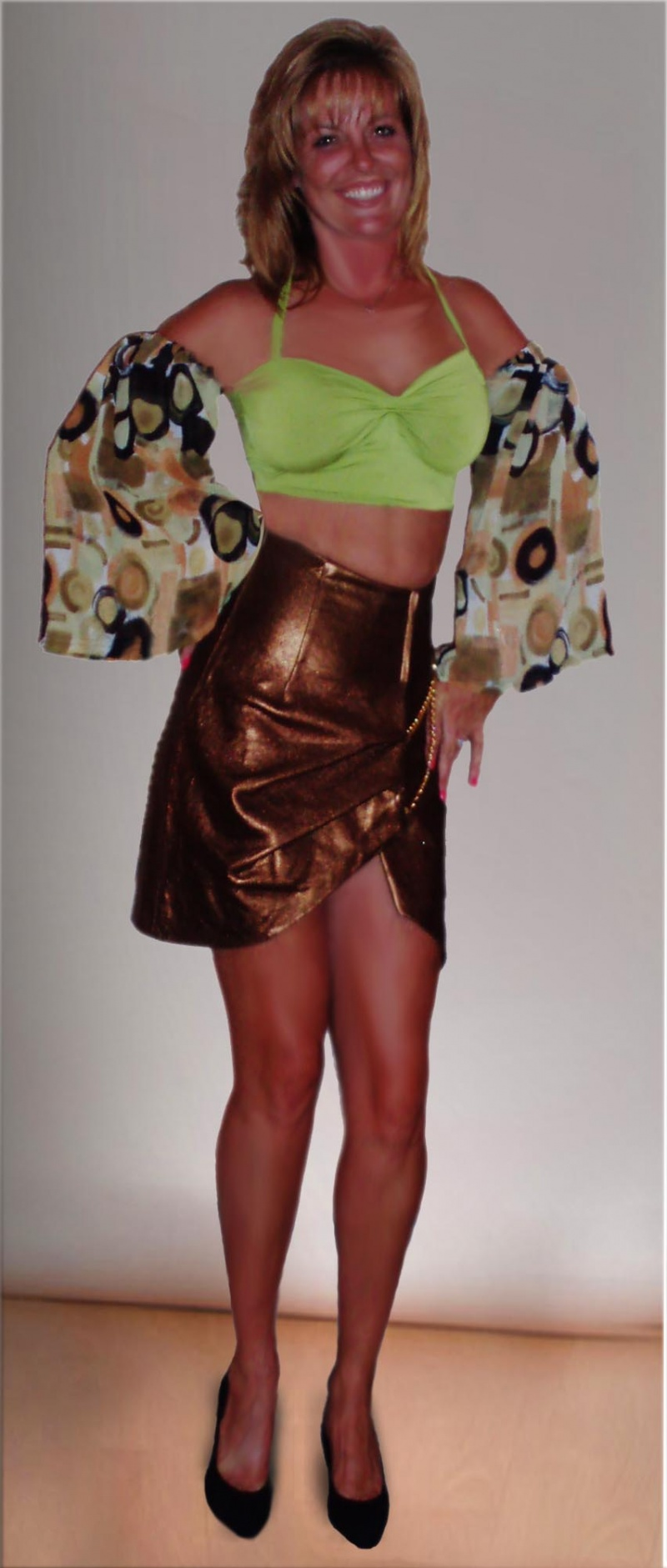 Private shoot Sep 11, 2009 Retro Metallic Collection; leather skirt and knit top with chiffon sleeves