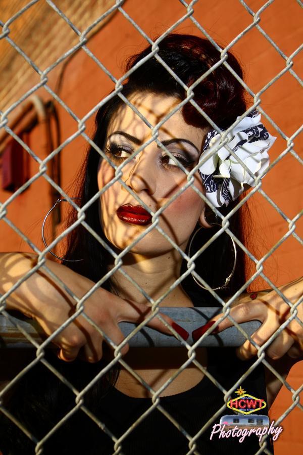 Wells Dec 28, 2009 Jordan Delacruz Photography 2009 Lauren Luck through the fence during golden hour