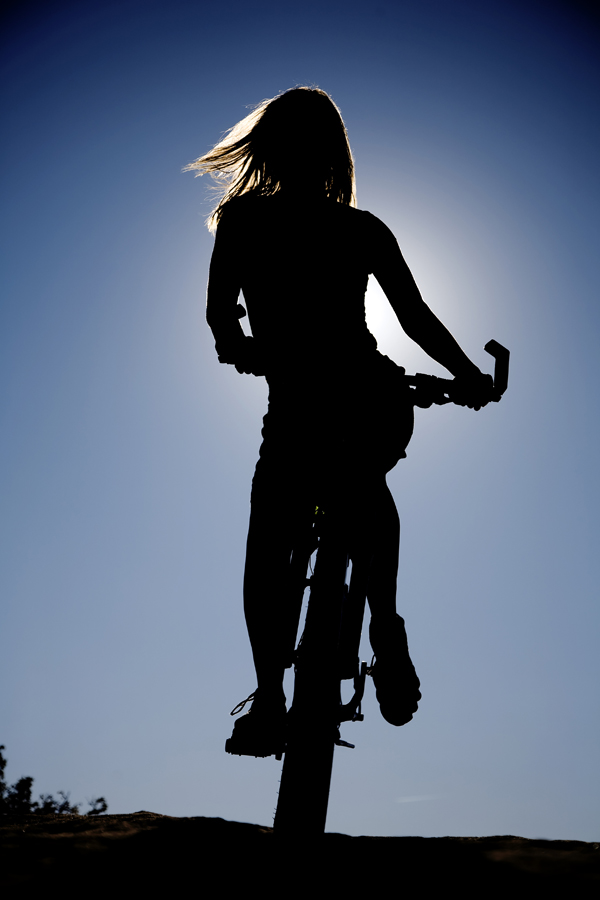 Duchesne, UT Feb 18, 2010 Poulsons Photography Silhouette of a woman on a bike  (Model: Deena Skewes)