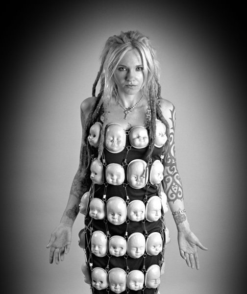 Mar 19, 2010 Photo by LA CityBeat The Baby Doll Dress: All of the doll heads on this dress were sculpted by me out of polymer clay from which molds were made and then cast out of a lightweight resin. They were then connected together with stainless steel rings and diaper pins.