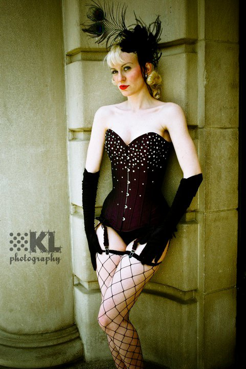 Female model photo shoot of Cherrybonbon by Karin Locke Photography, clothing designed by Sweet Carousel Corsetry