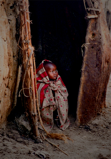 35 MM days in East Africia Jun 23, 2010 © All photographs by PRIDE OF PARADISE PHOTOGRAPHY are protected by copyright law. No image may be used, edited, reproduced, transferred, published or distributed in any form or by any means without written permission.. Nomad child in dung hut.