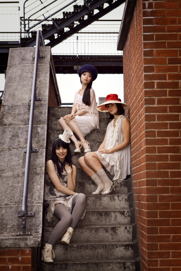 Female model photo shoot of GingerBread Hats, x Ann, Cyan C and Sophie Gore by Stormy Couture in Southbank, London, makeup by Erika J-R Wilson