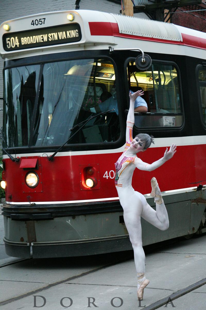 Queen Street, Toronto Nov 03, 2010 Dorola Nude Streetcar Ballet @ rush hour in traffic