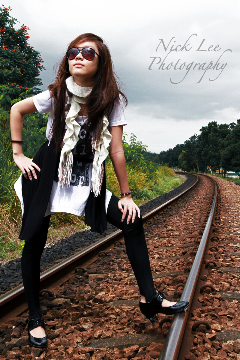 Male and Female model photo shoot of Nick Lee and Sheryl L in Bukit Timah Railway Track, Singapore