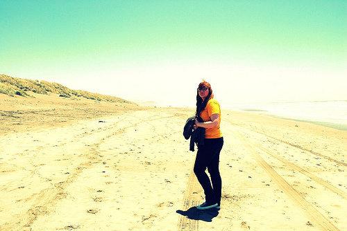 Female model photo shoot of Lekky Charms in ocean beach. sf.