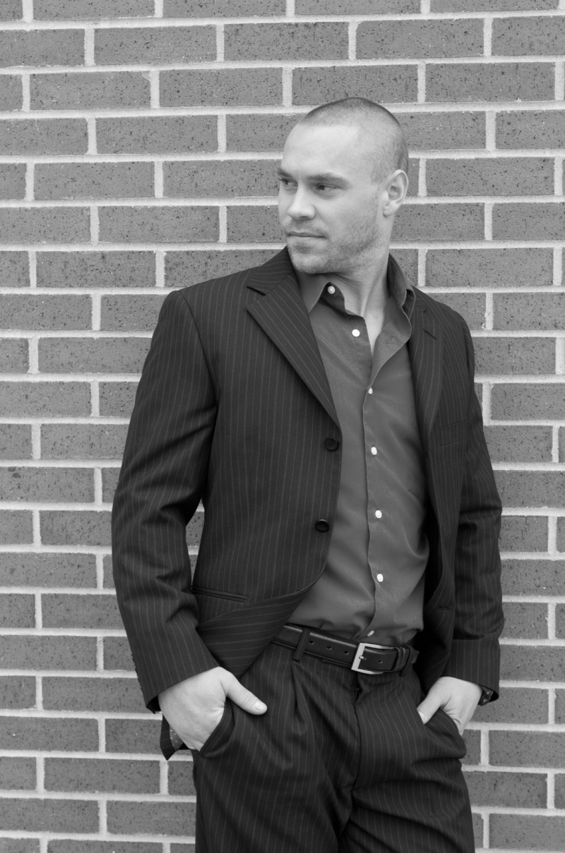 Male model photo shoot of Dustin Ward in old market omaha ne.