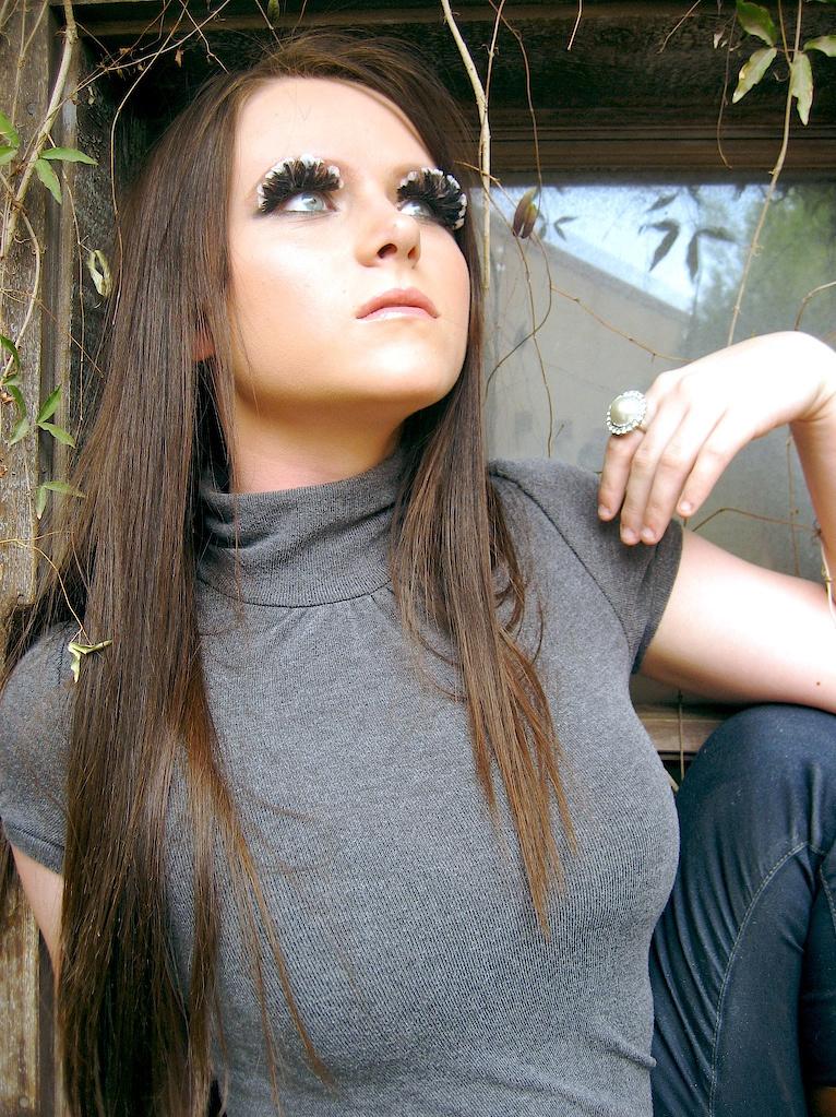 Female model photo shoot of Alluring Makeup