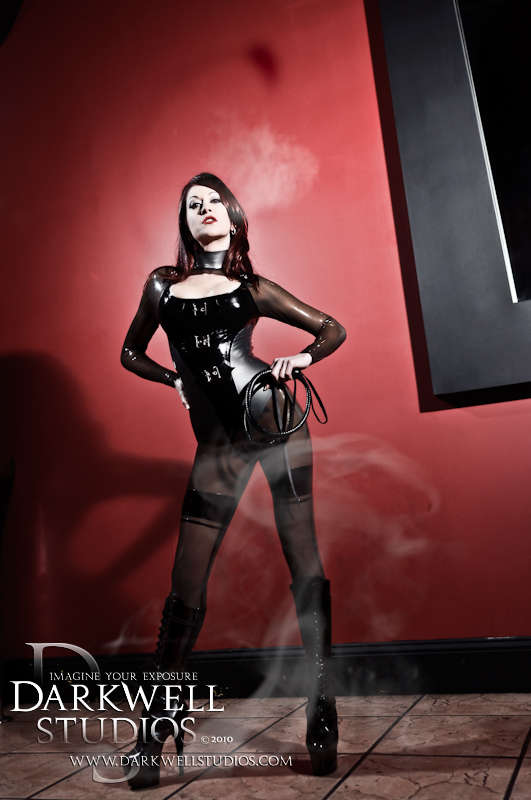 Male and Female model photo shoot of Darkwell Studios and Deanna Storm in Dominia (Club X), 681 Valley Street, Providence, RI, wardrobe styled by Latex Nemesis