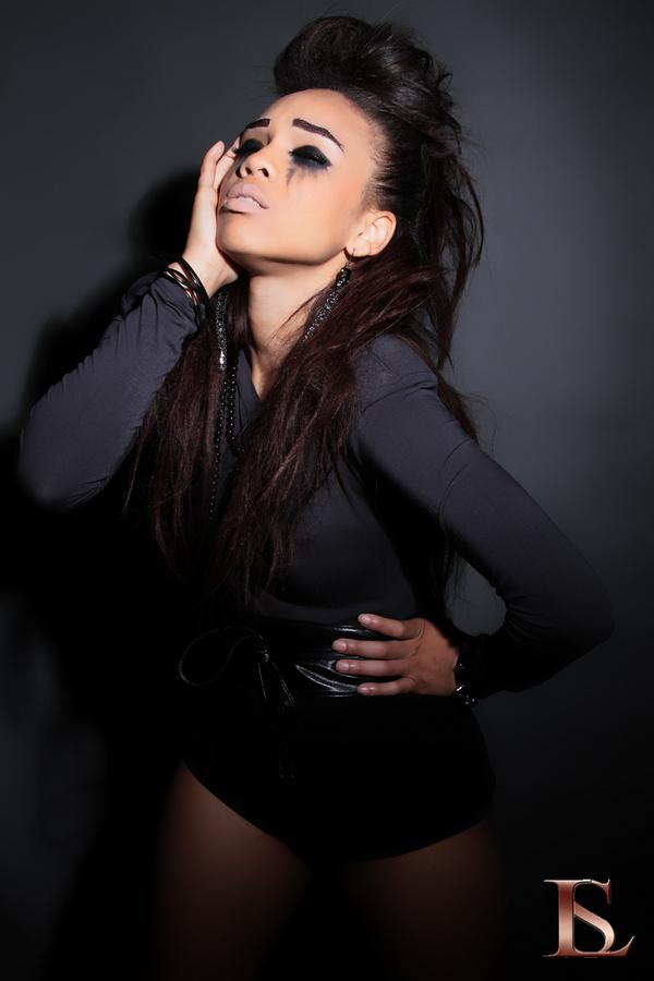 Female model photo shoot of Pretty Polka
