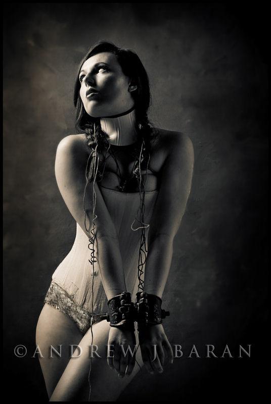 Female model photo shoot of the Madhat Kat by Andrew J Baran in Omaha, NE